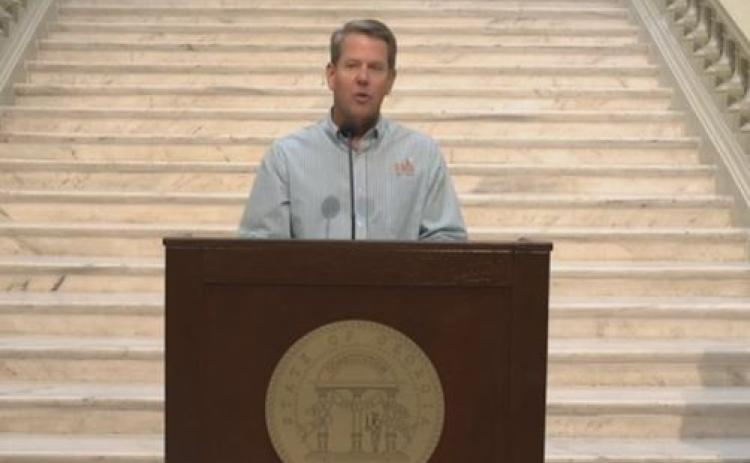 Gov. Brian Kemp speaking at the Capitol Building in Atlanta on Thursday.