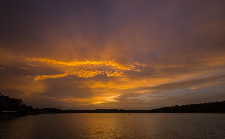 Sunshots by Bill Powell — The sun sets over Lake Hartwell and paints the sky hues of orange on Saturday, June 26, as a massive plume of dust from the Saharan Desert passes over the Southeastern U.S.