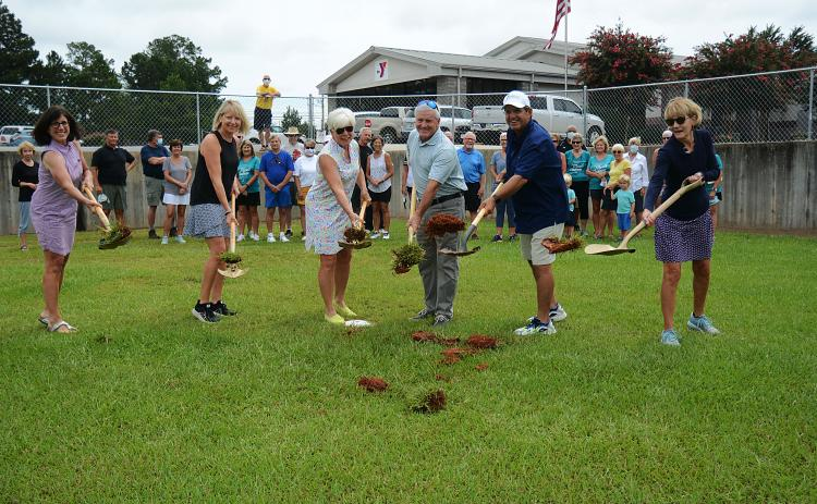 Sunshot by MIchael Hall - Above, Bell Family YMCA director Mandy Floyd, from left to right, and Lake Hartwell Pickleball Club members Angie Putman, Henley Cleary, president Eddie McCurley and Peggy Vickery break ground on what will become the club's outdoor courts at the YMCA in Hartwell on Monday, Aug. 24.