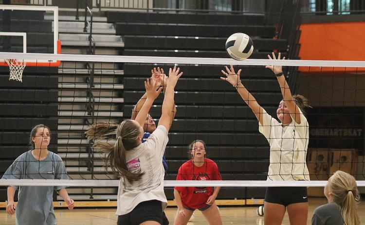 Sunshot by Grayson Williams — The Hart County volleyball team practices at the gym at Hart County High School on Monday, Aug. 3. The team is eyeing a deeper playoff run this season.