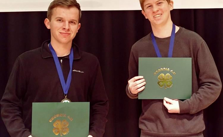 Photos submitted James Turpin, left, and Sean Leard, above, show off their certificates for participating in a recent virtual state competition.