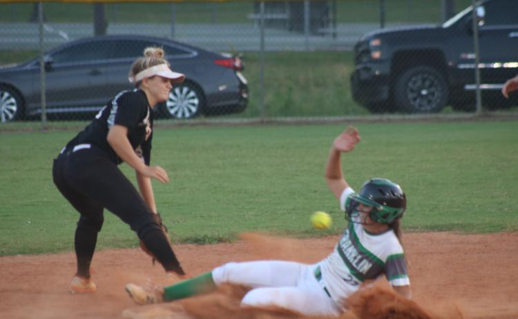 Sunshot by Grayson Williams - Hart County's Anslee Mitchell fields a throw in an attempt to get a Franklin County base runner out on Sept. 3 in Franklin County.