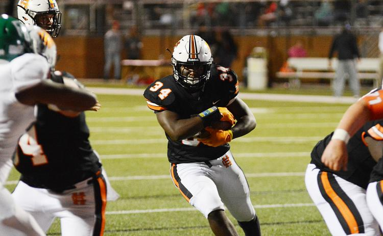 Hart County running back J.L. Lackey finds a hole to run through last week against Franklin County at Herndon Stadium.