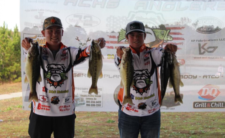 Joshua Haley and Jacob Fowler show off their catches in the middle school portion of the intra-squad tournament the Hart County middle and high school anglers competed in last weekend.  Photo submitted