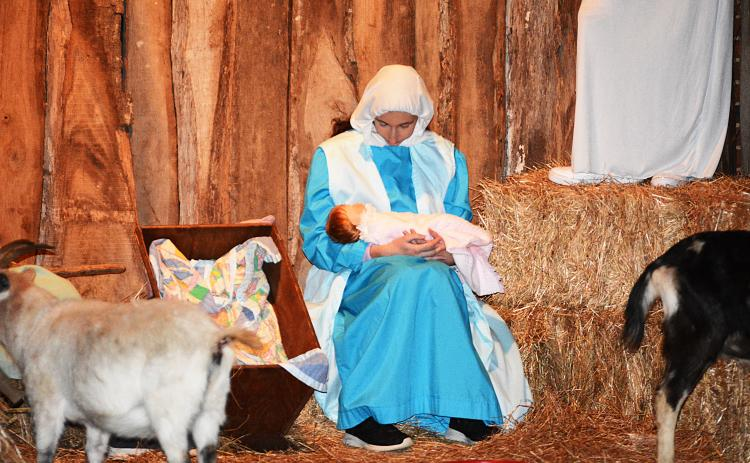 Sunshot by Michael Hall — Mary looks at baby Jesus during the Living Nativity at Cornerstone Baptist Church on Dec. 10.