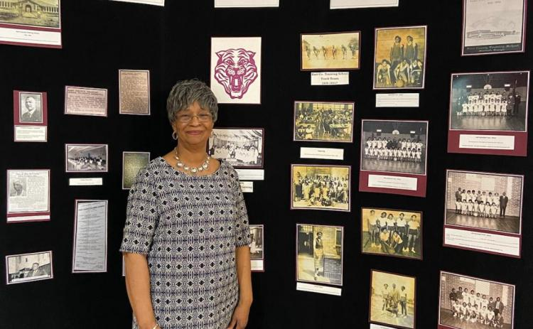 Loretta King poses for a photo in February with the African-American history exhibit she put together at The Art Center.