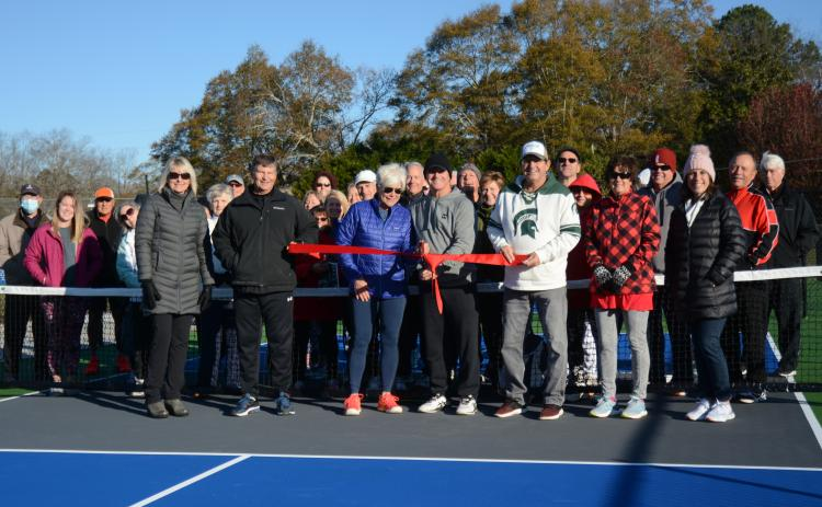 Sunshot by Michael Hall In the front row, Angie Putman, CEO of YMCA of Georgia's Piedmont, Joby Scroggs, Henley Cleary, Eddie McCurley, Frank Gunder, Kathy McCurley and Bell Family YMCA director Mandy Floyd cut the ribbon on new outdoor pickleball courts at the YMCA with Lake Hartwell Pickleball Club members behind them