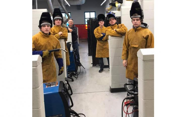 Photo submitted — Hart County High School welders who earned their technical college certification in welding through a class taught by Mike Carey at Hart College and Career Academy pose for a photo recently.