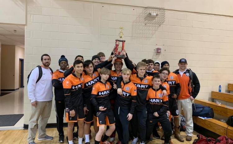 "Photo submitted - The Hart County wrestling team holds up its first-place trophy after winning the ""King of the Mountain"" tournament on Dec. 5 in Towns County."