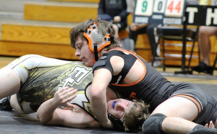 Photo submitted by Mandy Patton - Zander Bradsher wrestles against an opponent at a meet on Jan. 5.